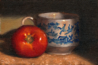 Oil painting of a red tomato beside a Willow Pattern tea cup.