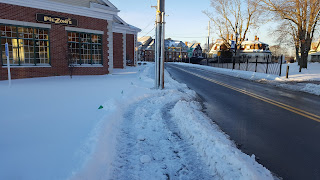 evidence that the DPW does get to clear the sidewalks of snow. However one must also ask if the Downtown Project took so long, to plan, couldn't they at least have put the pole on the side of the sidewalk?