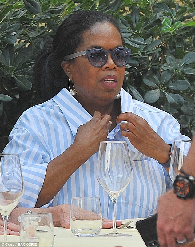 Oprah Winfrey looks effortlessly chic as she's mobbed by fans during Italian breakaway