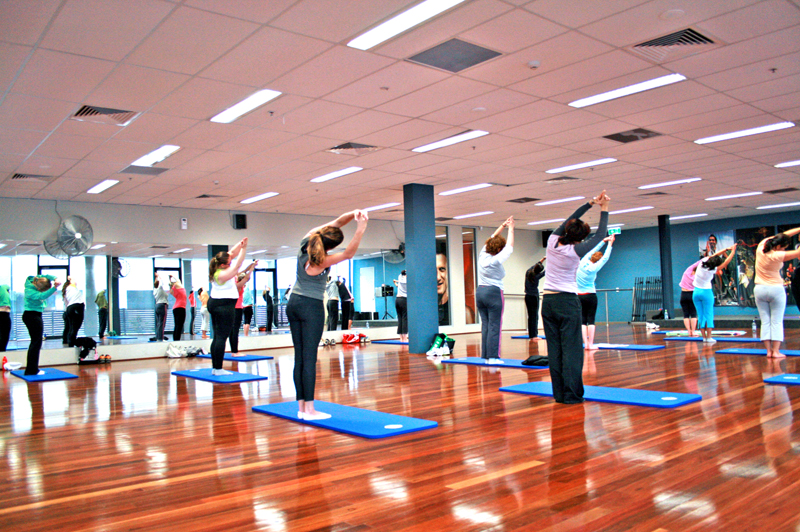 women in a yoga class at a gym
