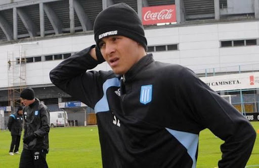 Racing Club player Giovanni Moreno was threatened at gunpoint by several hooligans