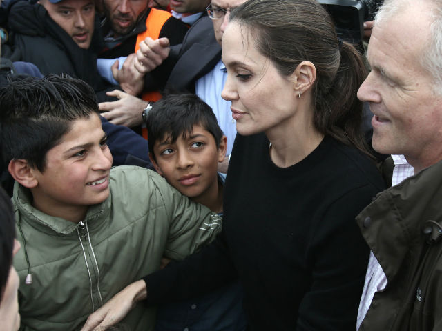 ANGELINA JOLIE MOBBED BY MEDIA AT THE EXILE CAMPS IN GREECE - HOLLYWOOD NEWS