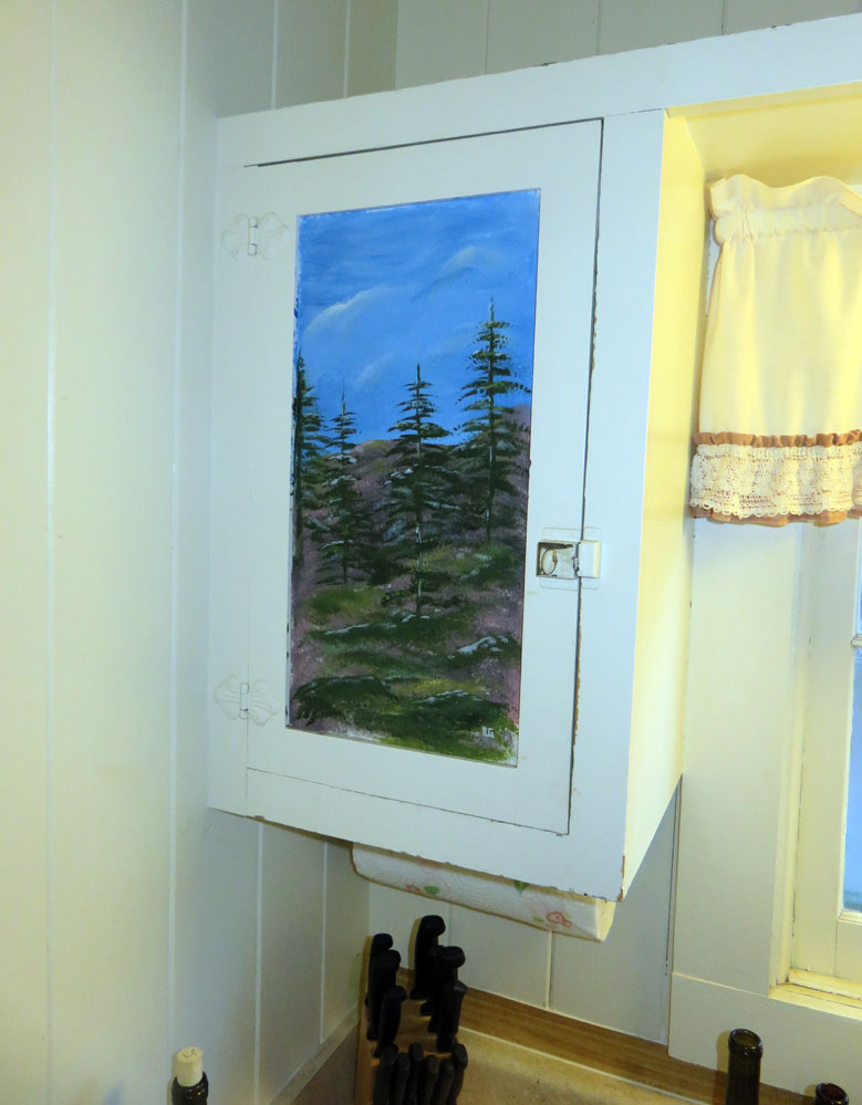 Painting on cabinet door.