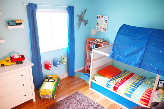 A Toddler Room With Vintage Trucks And An Airplane Oh My