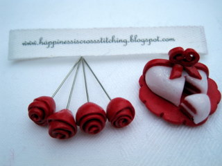 Polymer clay roses tutorial showing how to make these red roses using polymer clay and pins