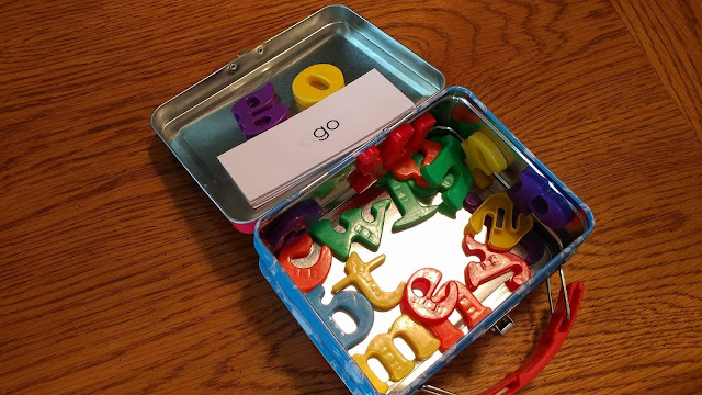 Magnetic letters in a mini lunchbox tin