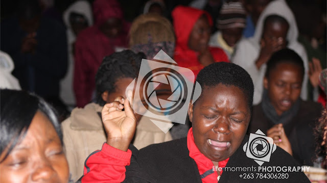 Woman In Deep Worship During The Service