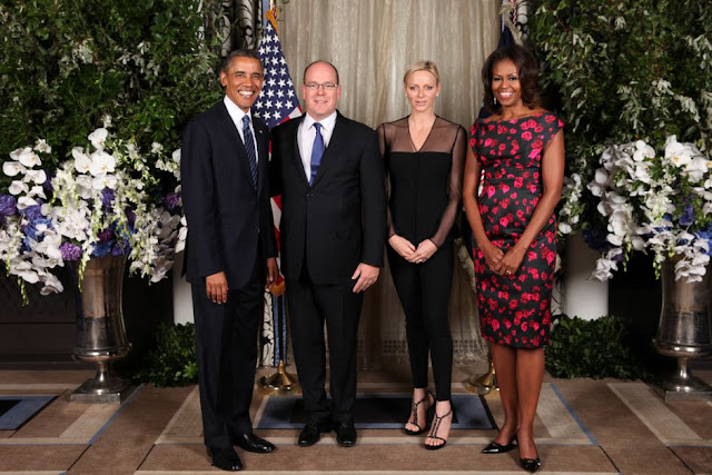 shop Princess Charlene's black Akris jacket michelle obama