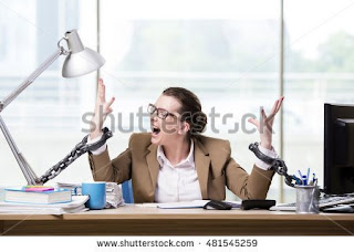 https://www.shutterstock.com/es/image-photo/woman-chained-her-working-desk-481545259