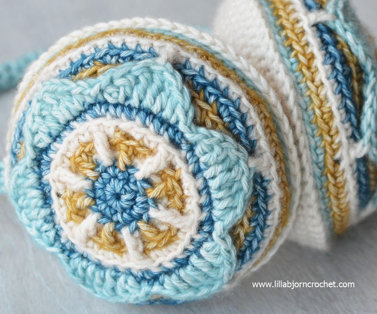 Crocheted ear muffs with flower. Designed by Lilla Bjorn Crochet - overlay crochet