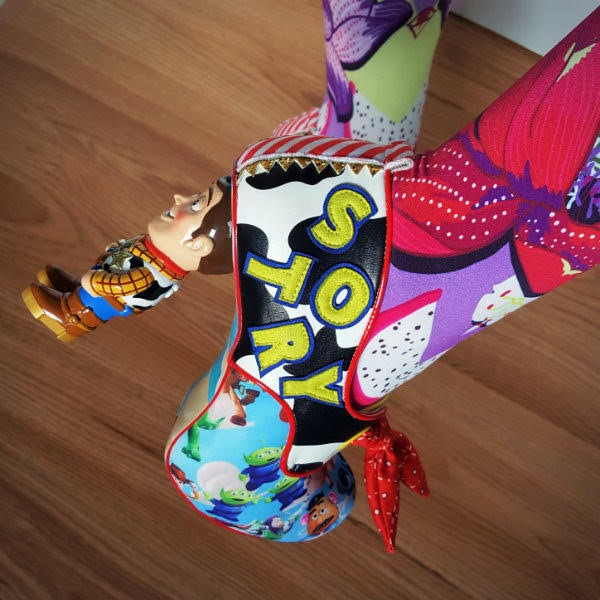 close up of foot wearing Toy Story Woody character heeled shoe