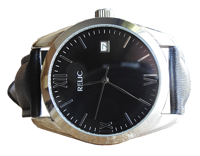 A Relic brand man's watch with silver housing and black leather band.