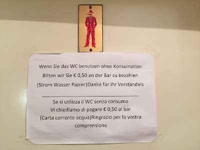 Sign at Albergo Signaterhof asking customers to chip in some money if they are just using the bathroom