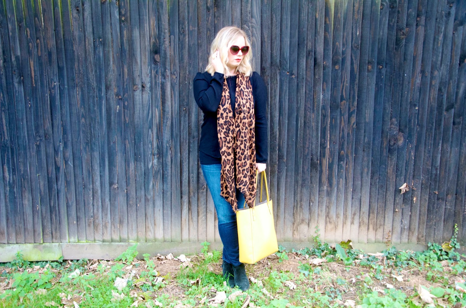 Jeans, leopard, yellow purse and distressed wooden wall