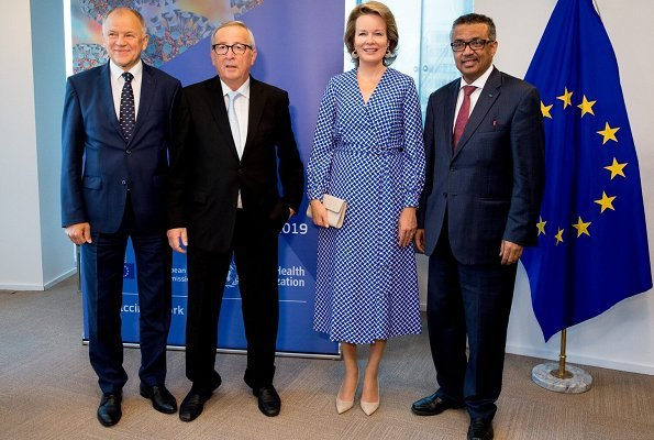Queen Mathilde's outfit was by Dries Van Noten. European Commission President Jean Claude Juncker