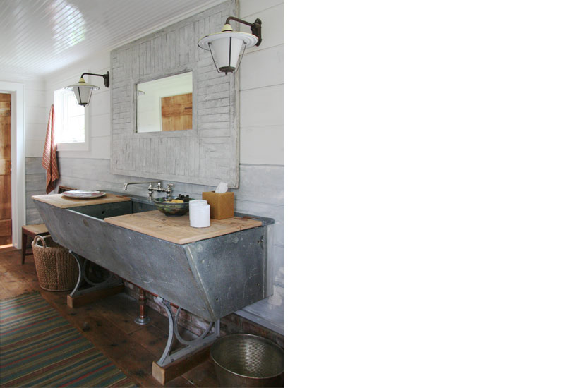 Rustic galvanized country sink in Barn conversion home by Carrier and Company