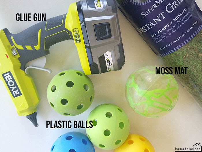 moss mat, plastic balls and Ryobi hot glue gun for making decorative moss balls
