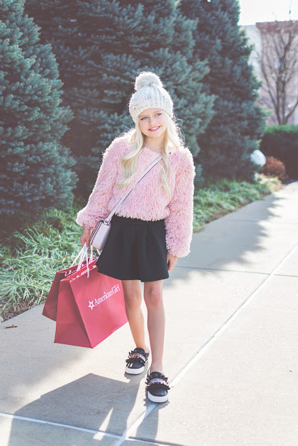 fur sweater girl outfit idea beanie skirt sneakers glitter ruffle kate spade winter christmas outfit