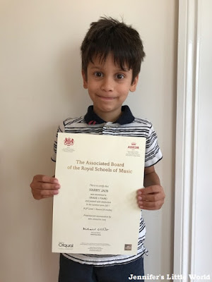 Child with a piano exam certificate