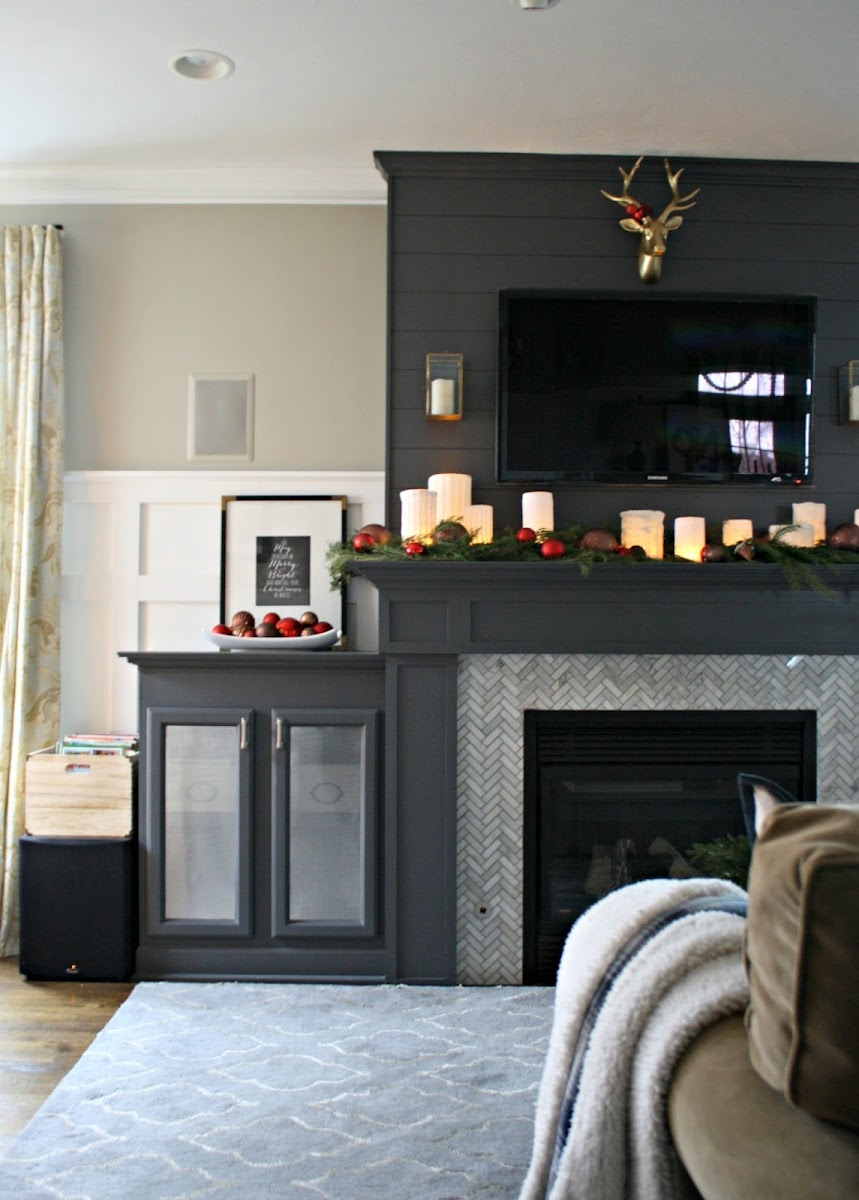 fireplace with built ins for electronics