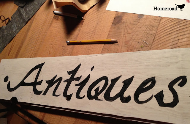 Antiques sign on reclaimed wood