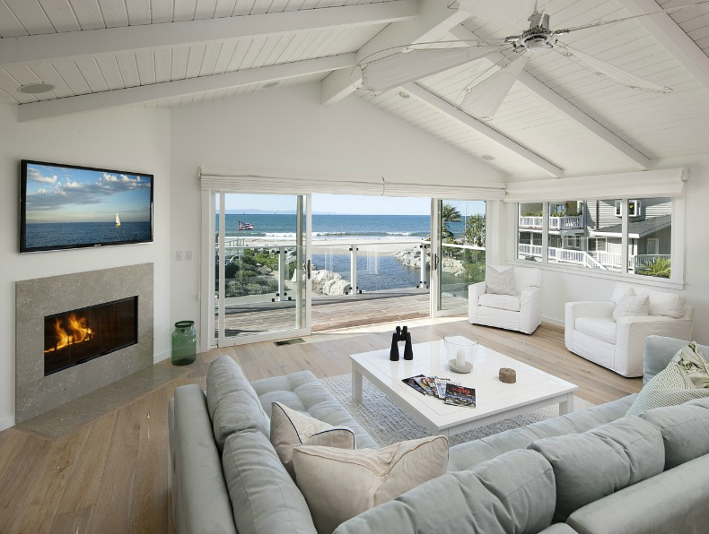 Coastal room with white slipcovered furniture