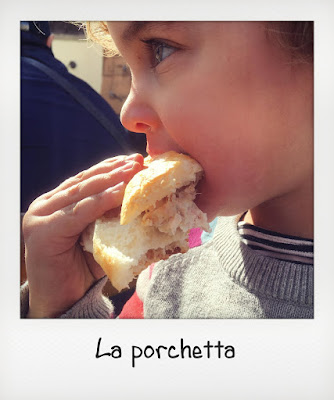 Bambina mangia panino con la porchetta a Frascati