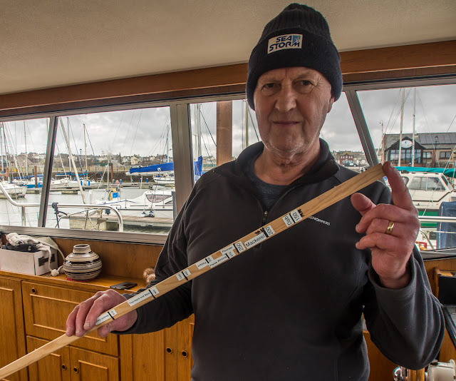 Photo of Phil with his new fish measuring stick