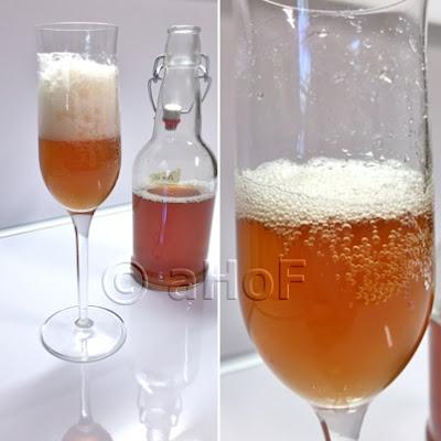 Pomegranate Kombucha in Champagne flute