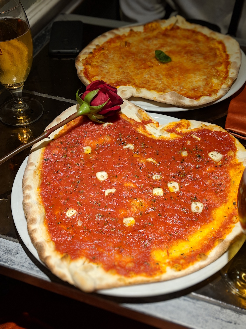 A vegan marinara, heart-shaped pizza from That's Amore in Rome