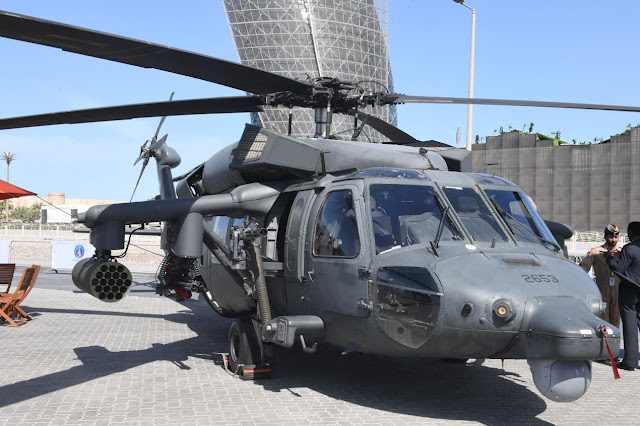 Image Attribute: UAE's newly modified UH-60M with the weaponized kit from AMMROC at IDEX 2019