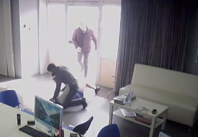CCTV footage shows moment a man walked in on a woman about to be raped at knife point - pushing her attacker off and hogtied him to subdue him until police picked him up.  The 28-year-old mom-of-one, Ekaterina, was at her workplace - a shop selling stretch ceilings in the Russian city of Krasnoyarsk when the horrific incident occurred.