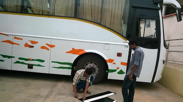 Team ksrtc blog bangalore guys doing sticker work on ksrtc volvo bus
