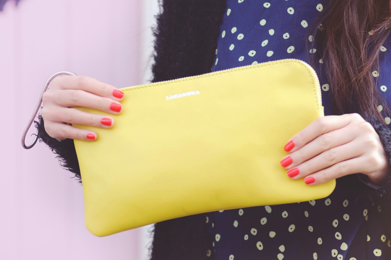 red nail polish, yellow clutch bag