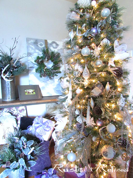 Decorating a Christmas Tree with HomeGoods ornaments