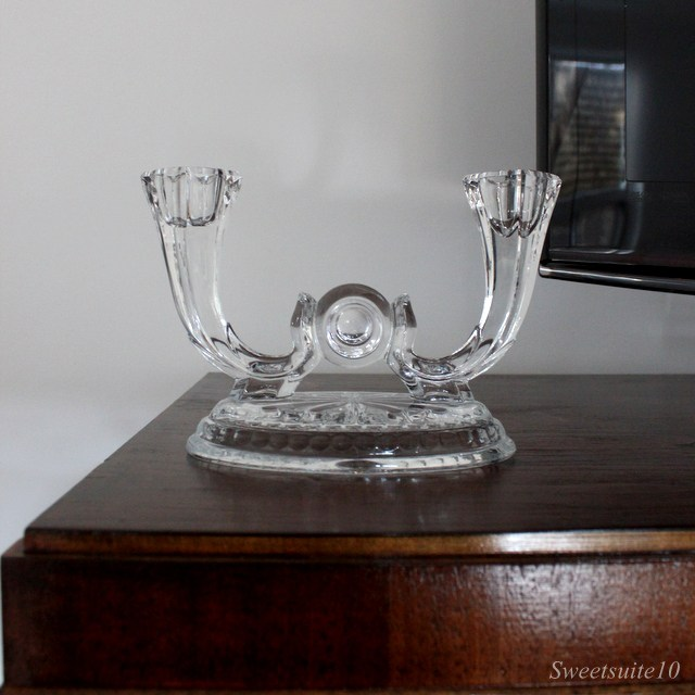 two-armed glass candleabra