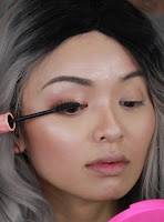 Apply a generous amount of Benefit Cosmetics Roller Lash Curling & Lifting Mascara to the upper