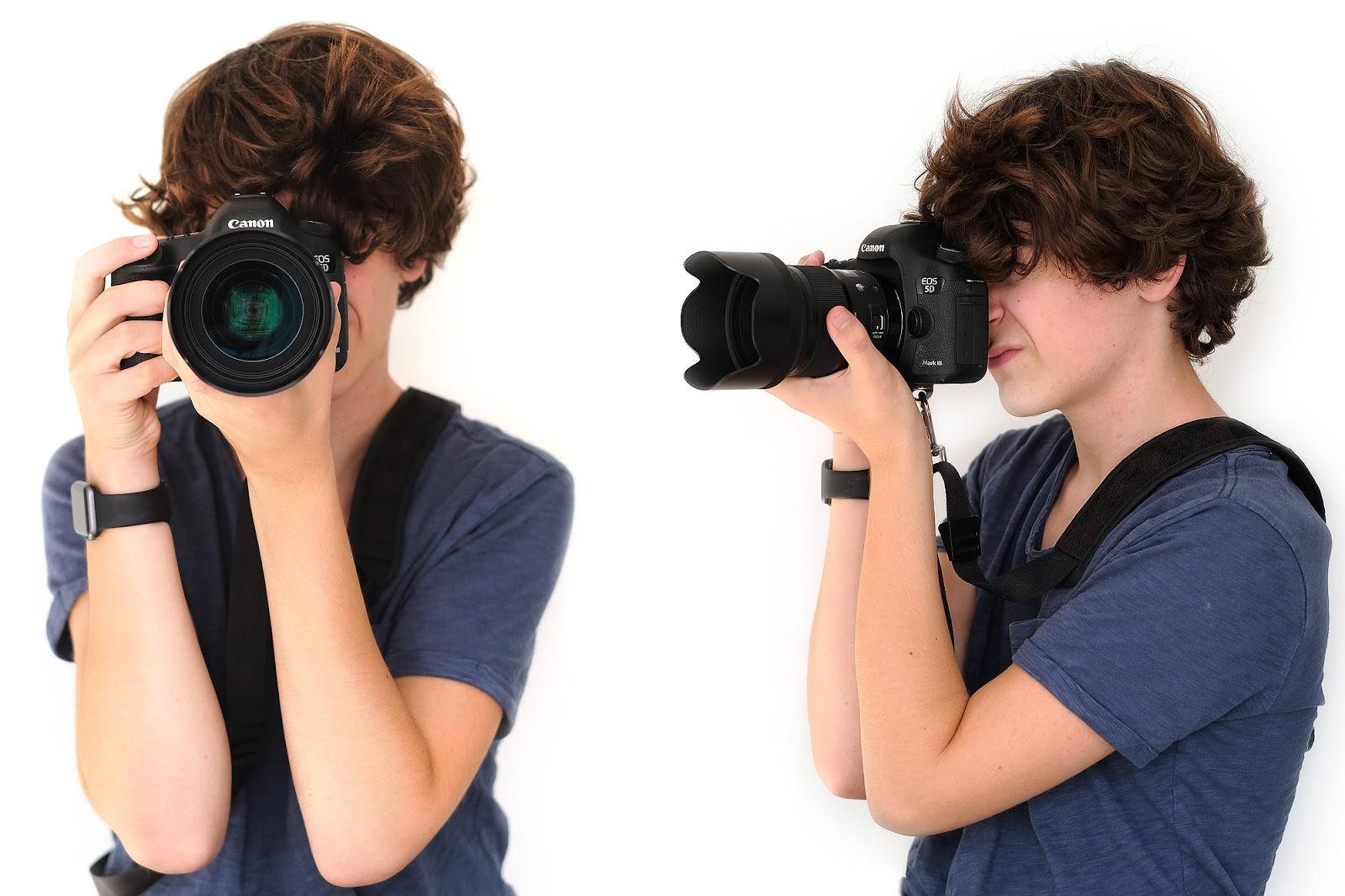 goede houding tijdens het vasthouden van een camera en lens tijdens het fotograferen