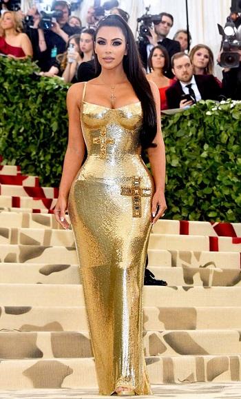 Kim Kardashian Stuns In Golden Gown At Met Gala