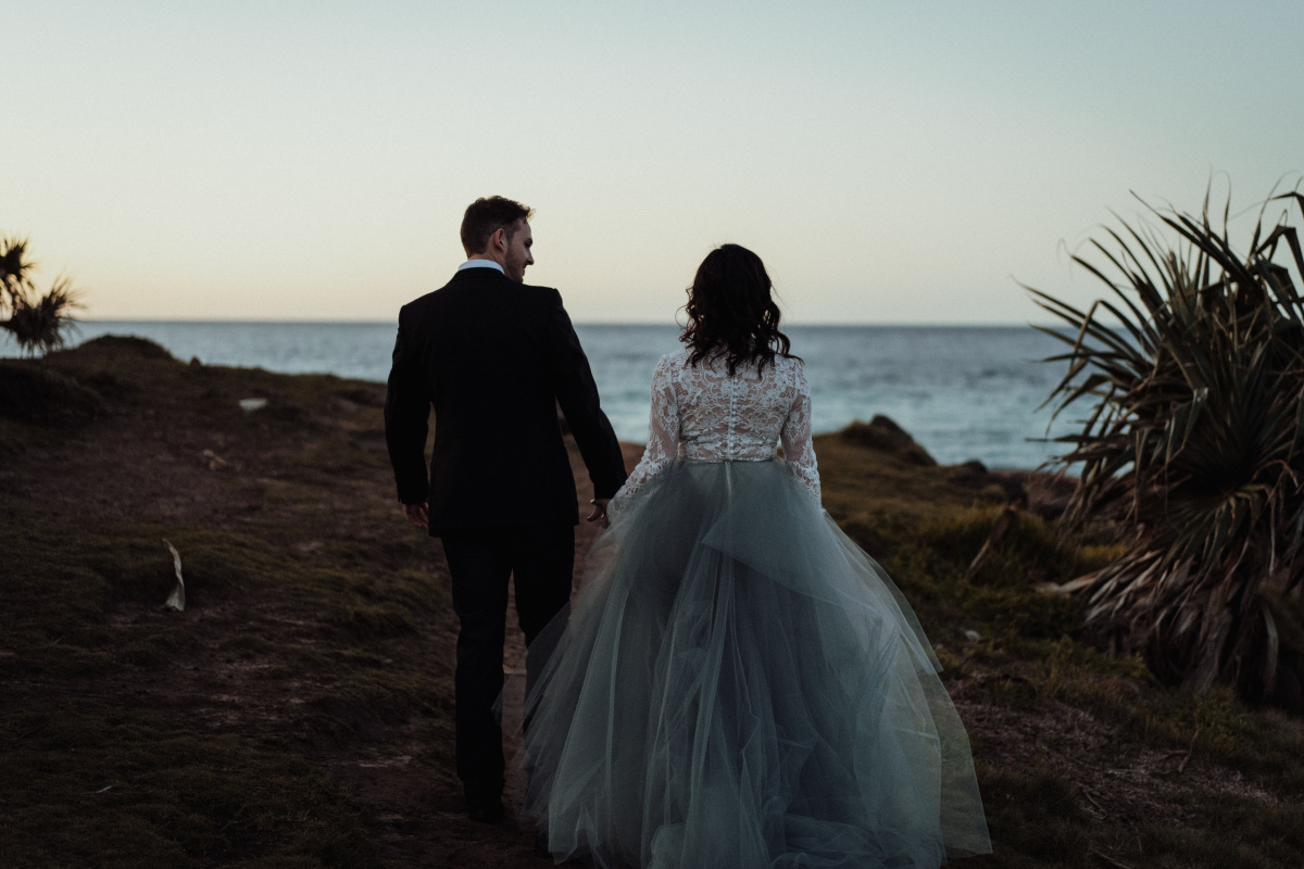 white parrot film and photography beach wedding elopement australian designer dark moody bridal fingal head
