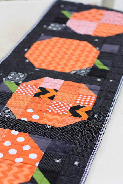 and there you go u2013 a simple patchwork pumpkin halloween quilt table runner you could easily multiply this project by six creating six rows to make a