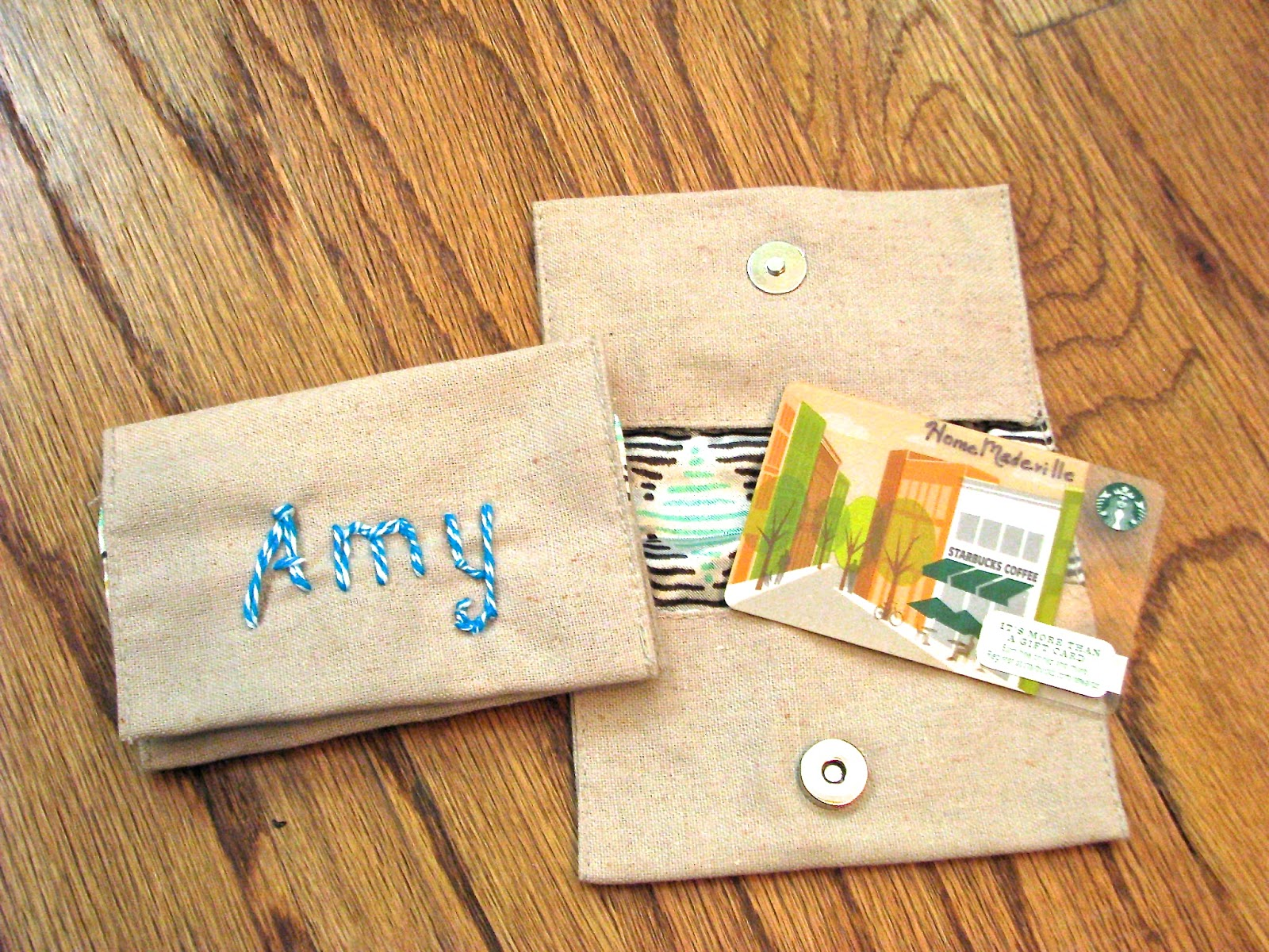 A gift card holder with name monogrammed with baker's twine.