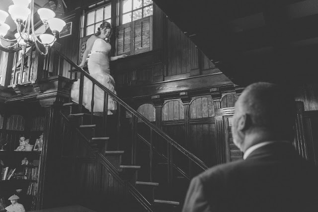 brides father first look on stair case
