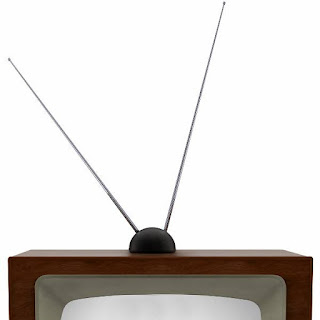 Vintage television with a set of older rabbit ears type antenna.