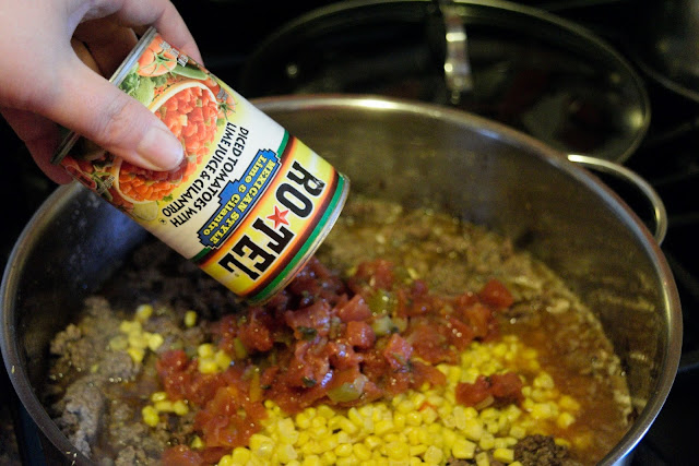 A can of Ro*Tel Tomatoes being added to the skillet
