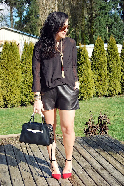 Topshop leather shorts, Helmut Lang Lyra Twist top and a Furla Diamante bag