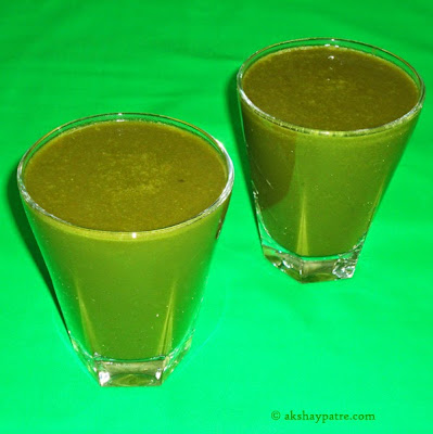 Palak soup poured in a glass