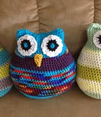 http://www.ravelry.com/patterns/library/owl-pillows-in-two-sizes