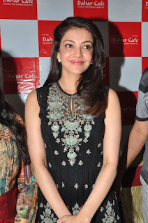 Kajal Aggarwal in lovely Black Sleeveless Anarlaki Dress in Hyderabad at Launch of Bahar Cafe at Madinaguda 044.JPG