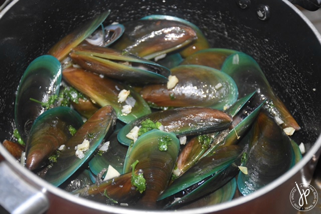 Mussels Buzara coated with olive oil, garlic, and fresh parsley